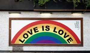 """A photo of a painted rainbow containing the words """"Love is Love"""" representative of LGBTQ pride and affirming therapy in Katy, TX."""