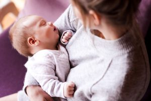 Happy Mom who participated in counseling and postpartum anxiety treatment in West Houston. 77494