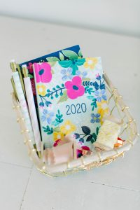 Photo of a basket containing a 2020 planner representing the New Years resolutions this anxious mom is setting for 2020. Moms who struggle with anxiety can get help and support from Anne Russey Counseling in Katy, TX 77494.